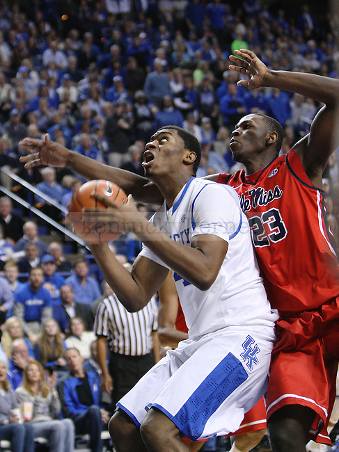 Ole Miss center Dwight Coleby (23) guards UK center Dakari Johnson (44) as he shoots a basket during second the half of UK Men's Basketball vs. Ole Miss at Rupp Arena in Lexington, Ky., on Tuesday, February 4, 2014. Photo by Emily Wuetcher | Staff