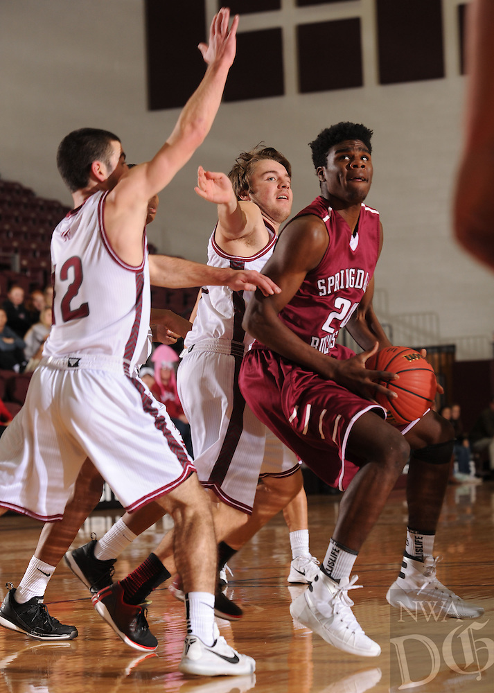 NWA Democrat-Gazette/ANDY SHUPE<br /> Towayne Bobo (right) of Springdale drives to the basket as Nathan Stolper (12) and Corbin Daniels of Tulsa (Okla.) Holland Hall defend Tuesday. Dec. 29, 2015, during the first half at Siloam Springs High School. Visit nwadg.com/photos to see more photographs from the game.