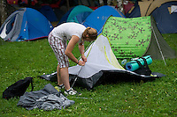 Participant pitches a tent on Sziget festival held in Budapest, Hungary on August 07, 2011. ATTILA VOLGYI
