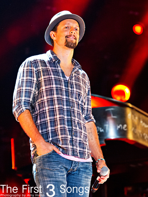 Jason Mraz performs with Hunter Hayes at LP Field during Day 2 of the 2013 CMA Music Festival in Nashville, Tennessee.