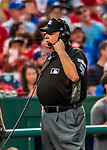 7 October 2017: Third Base Umpire Jerry Layne listens to a play review through headphones in the 4th inning of the second NLDS game against the Washington Nationals at Nationals Park in Washington, DC. The Nationals defeated the Cubs 6-3 and even their best of five Postseason series at one game apiece. Mandatory Credit: Ed Wolfstein Photo *** RAW (NEF) Image File Available ***