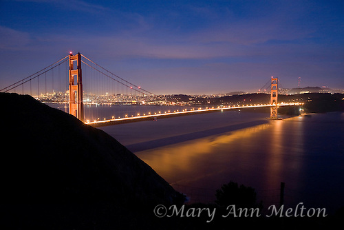 A blended image to get detail in the clouds and to avoid over exposing the lighting on the bridge.