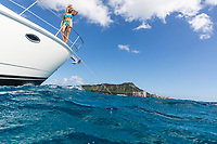 A woman enjoys the view aboard a power cruiser in the waters of Waikiki, O'ahu.