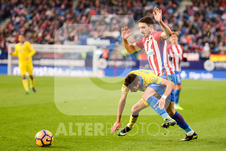 Atletico de Madrid Sime Vrsaljko and UD Las Palmas Helder Lopes during La Liga match between Atletico de Madrid and UD Las Palmas at Vicente Calderon Stadium in Madrid, Spain. December 17, 2016. (ALTERPHOTOS/BorjaB.Hojas)