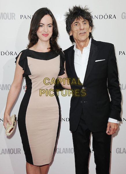 Sally Humphreys & Ronnie Wood.Women Of The Year 2012 - Glamour Awards, Berkeley Square, London, England..29th May 2012.half length black suit white shirt dress beige couple .CAP/WIZ.© Wizard/Capital Pictures.