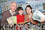 HISTORIANS: Denis Fenton from Cillin Liath National School, Shannon O'Donoghue and Mary McGarvey checking out some of the material  collected by the  Dromid Folklore Group.