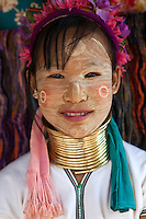 "Karen Hill Tribes living along the border with Myanmar in Thailand, The Padaung members of the Burmese Karen are also known as the Padaung or ""long-necks"" because of the heavy brass rings they wear around their necks. How they came to be ""long-necks"" is the stuff of legend. Long ago, the headman of the tribe had a dream in which he was told that a tiger was going to kill one of the children in the village, a child that had been born on a Wednesday.  Since tigers kill their victims by first breaking their necks, the headman decreed that all children born on a Wednesday should wear heavy brass rings round their necks."