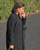 National Security Advisor Susan Rice speaks on the phone as she walks to Marine One to join United States President Barack Obama as he departs the White House in Washington, DC en route to Joint Base Andrews in Maryland from where he will fly to Turkey for the G20 Summit on Saturday, November 14, 2015.<br /> Credit: Ron Sachs / Pool via CNP
