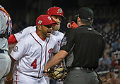 Washington Nationals manager Dave Martinez (4) and right fielder Bryce Harper (34) argue with umpire D.J. Reyburn (17) after Harper was ejected from the game in the twelfth inning against the New York Mets at Nationals Park in Washington, D.C. on Thursday, September 20, 2018.  The Mets won the game 5 - 4 in twelve innings.<br /> Credit: Ron Sachs / CNP<br /> <br /> (RESTRICTION: NO New York or New Jersey Newspapers or newspapers within a 75 mile radius of New York City)