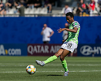 GRENOBLE, FRANCE - JUNE 12: Halimatu Ayinde #18 of the Nigerian National Team passes the ball during a game between Korea Republic and Nigeria at Stade des Alpes on June 12, 2019 in Grenoble, France.