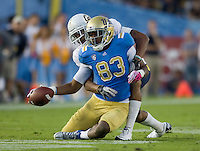 Marc Anthony of California tackles Nelson Rosario of UCLA during the game at Rose Bowl in Pasadena, California on October 29th, 2011.  UCLA defeated California, 31-14.