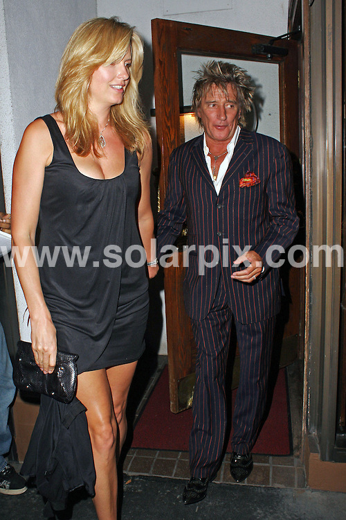 **ALL ROUND PICTURES FROM SOLARPIX.COM**.**WORLDWIDE SYNDICATION RIGHTS**.**NO PUBLICATION IN AUSTRALIA, NEW ZEALAND, DENMARK, GERMANY OR USA**.Rod Stewart and his wife Penny Lancaster enjoy a late night dinner at Madeo Restaurant in Beverly Hills California and are surrounded by paparazzi upon their departure...JOB REF:7319-LAP/JS       DATE:12_09_08 .**MUST CREDIT SOLARPIX.COM OR DOUBLE FEE WILL BE CHARGED* *UNDER NO CIRCUMSTANCES IS THIS IMAGE TO BE REPRODUCED FOR ANY ONLINE EDITION WITHOUT PRIOR PERMISSION*