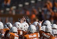 24 November 2006: Texas players gather at mid-field during warmups before the Longhorns 12-7 loss to the Texas A&M University Aggies at Darrell K Royal Memorial Field in Austin, TX.