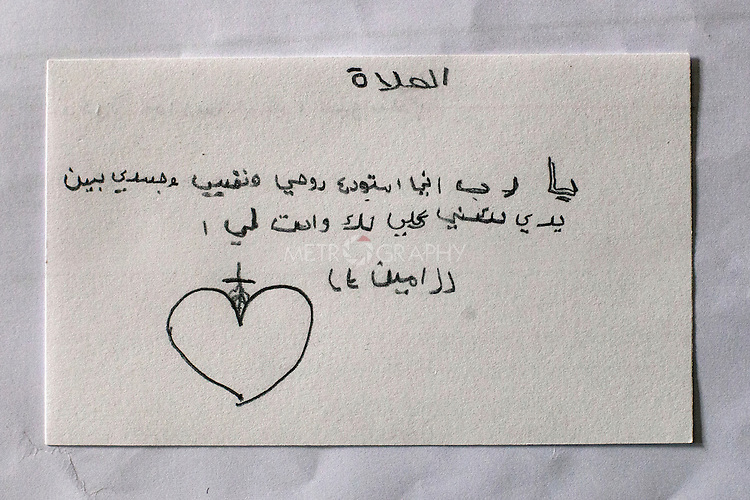 "18/10/14. Erbil, Iraq. A note from Wassam to his uncle Salam, ""Lord, I give my soul and body completely to you to hold."""