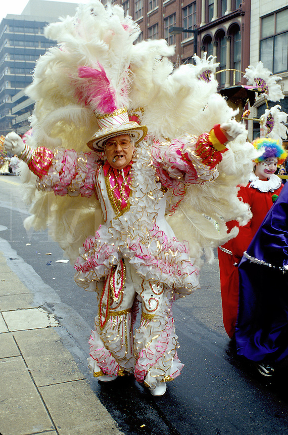 parade, costume, Philadelphia, PA, Pennsylvania, A man dressed in a fancy white suit with feathers struts in the Fancy Division in the Mummers Day Parade on New Years Day in Philadelphia.
