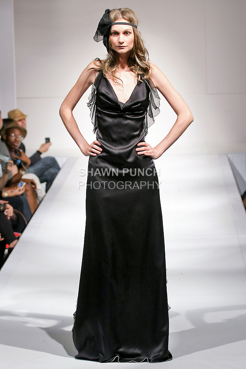 Model walks the runway in an outfit by Stella Simona, for the Stella Simona Spring Summer 2011 fashion runway show, during Nolcha Fashion Week, September 14, 2010.