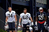 July 26, 2018: New England Patriots guard Joe Thuney (62) flanked by offensive lineman Cole Croston (74) and linebacker Marquis Flowers (59) heads to practice at the New England Patriots training camp held on the practice fields at Gillette Stadium, in Foxborough, Massachusetts. Eric Canha/CSM