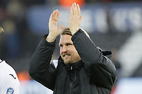 Bjorn Hamberg, assistant coach for Swansea applauds home supporters during the FA Cup Fourth Round match between Swansea City and Gillingham at the Liberty Stadium, Swansea, Wales, UK. Saturday 26 January 2019