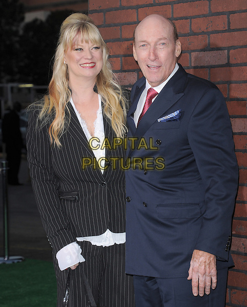 "Marchell Williams & Ed Lauter .""Trouble With The Curve"" Los Angeles Premiere held at the Regency Village Theatre, Westwood, California, USA..September 19th, 2012.half length married husband wife suit black blue tie pink shirt .CAP/RKE/DVS.©DVS/Capital Pictures."