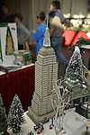 Garden City, New York, USA. December 1, 2013. The Winter holiday Festival of Trees includes elaborate Department 56 displays, including the Empire State Building in the Christmas in the City Historical Landmark series. The event was held at Cradle of Aviation Museum during Thanksgiving weekend, with proceeds benefiting United Cerebral Palsy Association of Nassau County, Long Island.