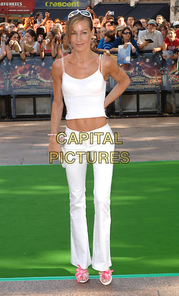 TARA PALMER THOMPKINSON.Charlie And The Chocolate Factory Premiere,.Odeon Cinema, Leicester Square, .london, 18th July 2005.full length white trousers strappy top sunglasses pink flower sandals shoes clutch bag.www.capitalpictures.com.sales@capitalpictures.com.©Capital Pictures.