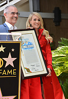 LOS ANGELES, CA. September 20, 2018: Carrie Underwood &amp; Mitch O'Farrell at the Hollywood Walk of Fame Star Ceremony honoring singer Carrie Underwood.<br /> Pictures: Paul Smith/Featureflash