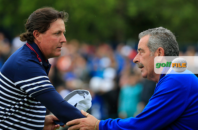 Phil Mickelson (USA) shakes hands with Sam Torrance during  the Sunday Singles Matches at the 2014 Ryder Cup at Gleneagles. The 40th Ryder Cup is being played over the PGA Centenary Course at The Gleneagles Hotel, Perthshire from 26th to 28th September 2014.: Picture Fran Caffrey, www.golffile.ie: \28/09/2014\