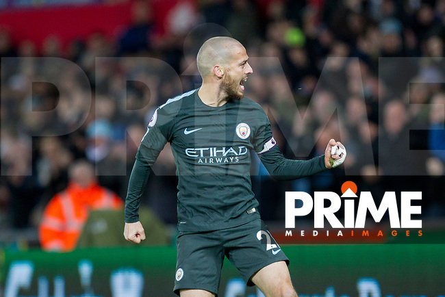 David Silva of Manchester City celebrates scoring his side's third goal during the EPL - Premier League match between Swansea City and Manchester City at the Liberty Stadium, Swansea, Wales on 13 December 2017. Photo by Mark  Hawkins / PRiME Media Images.