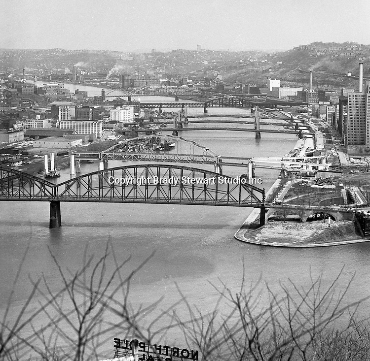 Pittsburgh PA:  View of the bridges across the Allegheny River - 1962.  Manchester, Fort Duquense, 6th, 7th, 9th Street, Fort Wayne Railroad, and 16th Street Bridges