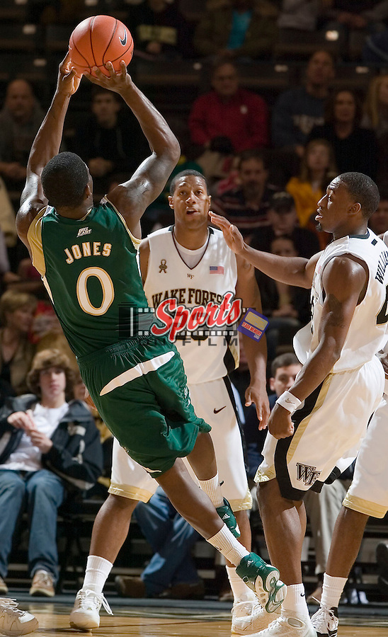 South Florida's Dominique Jones (0) fires up an off-balance shot after being fouled by Wake Forest's L.D. Williams (42) during first half action at the LJVM Coliseum Wednesday, December 19, 2007 in Winston-Salem, NC.