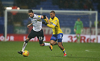 Bolton Wanderers' Will Buckley is tackled by Leeds United's Kemar Roofe<br /> <br /> Photographer Stephen White/CameraSport<br /> <br /> The EFL Sky Bet Championship - Bolton Wanderers v Leeds United - Saturday 15th December 2018 - University of Bolton Stadium - Bolton<br /> <br /> World Copyright &copy; 2018 CameraSport. All rights reserved. 43 Linden Ave. Countesthorpe. Leicester. England. LE8 5PG - Tel: +44 (0) 116 277 4147 - admin@camerasport.com - www.camerasport.com