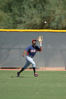 Cleveland Indians outfielder Junior Soto (33) catches a fly ball during an Instructional League game against the Texas Rangers on October 4, 2013 at Surprise Stadium Training Complex in Surprise, Arizona.  (Mike Janes/Four Seam Images)