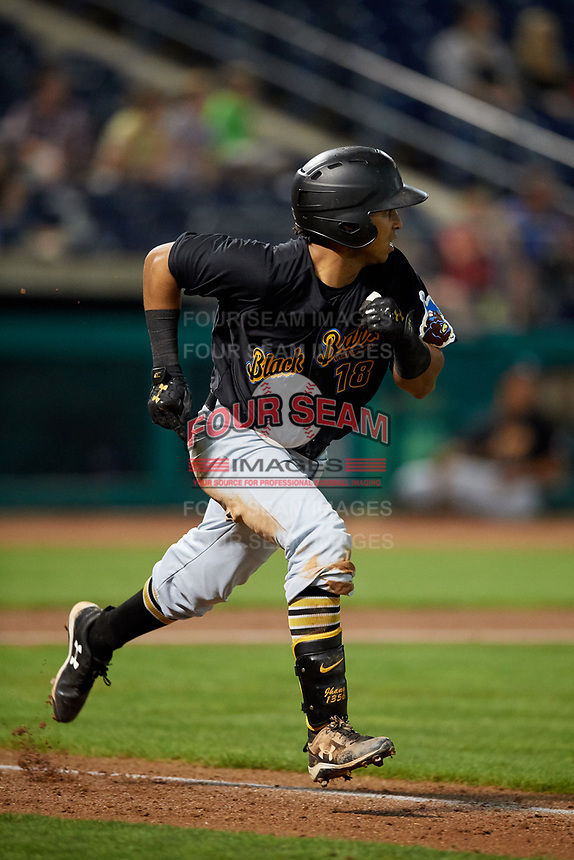West Virginia Black Bears left fielder Edison Lantigua (18) runs to first base during a game against the State College Spikes on August 30, 2018 at Medlar Field at Lubrano Park in State College, Pennsylvania.  West Virginia defeated State College 5-3.  (Mike Janes/Four Seam Images)