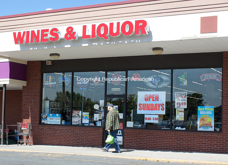 "NAUGATUCK, CT- MAY 17  2011-051712DA07- A large ""Open Sunday"" sign hangs in the store front of Mount View Wines & Liquor in the Mount View Plaza in Naugatuck after Governor Dannel P. Malloy signed Sunday liquor sales into law earlier this week. .Darlene Douty Republican American"