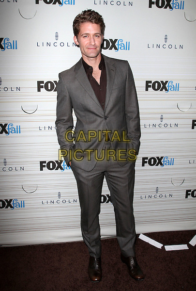 MATTHEW MORRISON.FOX's 2010 Fall Eco-Casino Party held at BOA Steak House, West Hollywood, CA, USA..September 13th, 2010.full length grey gray suit maroon shirt hands in pockets .CAP/ADM/KB.©Kevan Brooks/AdMedia/Capital Pictures.