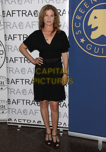 NANCY TRAVIS.Out of Silence - Readings From The Afghan Women's Writing Project  held at the Museum of Tolerance, Los Angeles, California, USA..March 8th, 2010.full length dress hand on hip black .CAP/ADM/TC.©T. Conrad/AdMedia/Capital Pictures.
