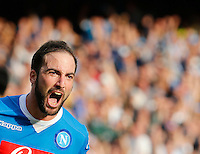 Napoli's Gonzalo Higuain  celebrates after scoring during the Italian Serie A soccer match between SSC Napoli and AC Fiorentina  at San Paolo stadium in Naples,October 18, 2015