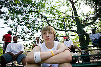 12 June 2006 - New York City, NY - Max von Helldorff (C), visiting New York City from Germany, watches players compete in the tryouts for the Ruckers street basketball tournament, at Ruckers Park in Harlem, New York City, USA, as he waits his turn to play, Sunday June 12 2005. Photo Credit: David Brabyn
