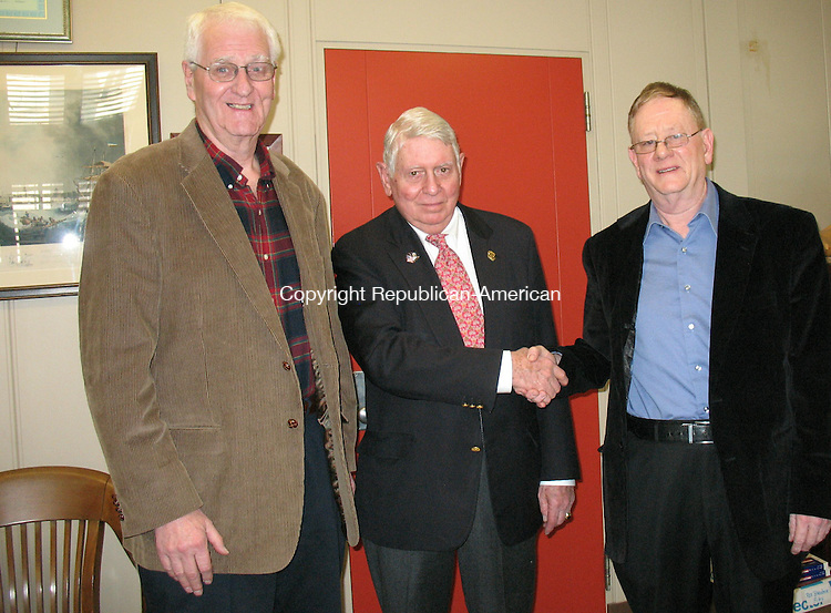 WATERBURY, CT - 11 March 2010 - Republican-American publisher, William J. Pape II, center, shakes hands Wednesday with Joe Sullivan, right, chairman of the Waterbury Elks Club's House Committee, for the club's $1,000 contribution to the Greater Waterbury Campership Fund. At left is John O'Connor chairman of the club's Scholarship Committee. The Campership Fund annually gives hundreds of underprivileged boys and girls, ages 7 to 13 from a 10-community region, the opportunity to attend a day, overnight or special needs summer camp for at least a week where they learn useful life skills under the supervision of adults who double as fine role models. The Republican-American has sponsored the Campership Fund for 41 years. Other partners include Sovereign Bank, Webster Bank, WATR radio 1320 and the Thomaston Savings Bank. Donations are tax deductible and acknowledged weekly in The Sunday Republican. Contributions should be sent to Michael Mucciacciaro, treasurer, Greater Waterbury Campership Fund, c/o the Republican-American, P.O. Box 2090, Waterbury 06722.