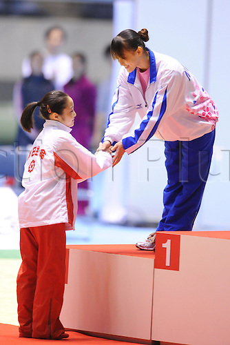 24.04.2011. Tokyo, Jpan.  Koko Tsurumi (JPN), Rie Tanaka (JPN), April 24th, 2011 - Artistic Gymnastics : Koko Tsurumi shake hands with Rie Tanaka during the all japan Artistic Gymnastics Individual championship at Yoyogi 1st Gymnasium, Tokyo, Japan.