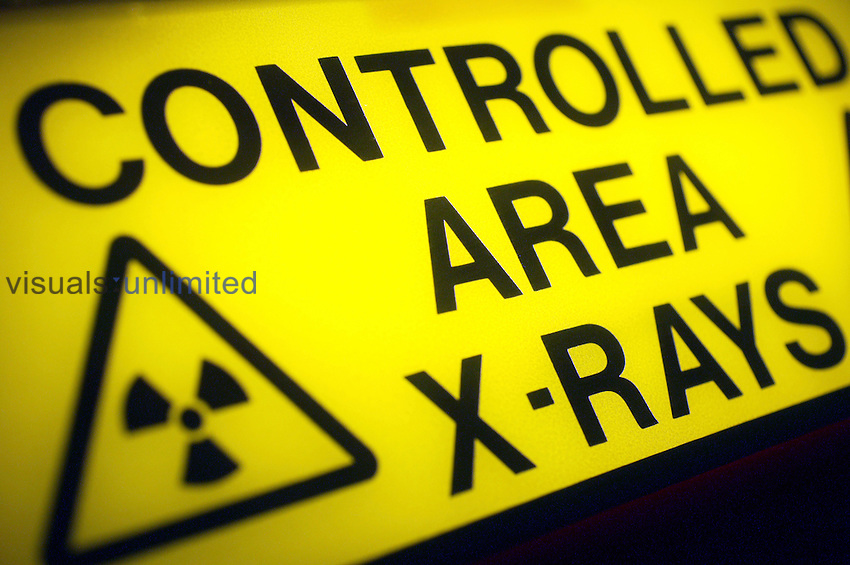 Yellow warning sign for x-ray room. Royalty Free