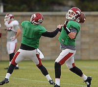NWA Media/ANDY SHUPE - Arkansas quarterbacks Brandon Allen, right, and Austin Allen, left, work through drills during practice Saturday, Dec. 13, 2014, at the university's practice facility in Fayetteville.