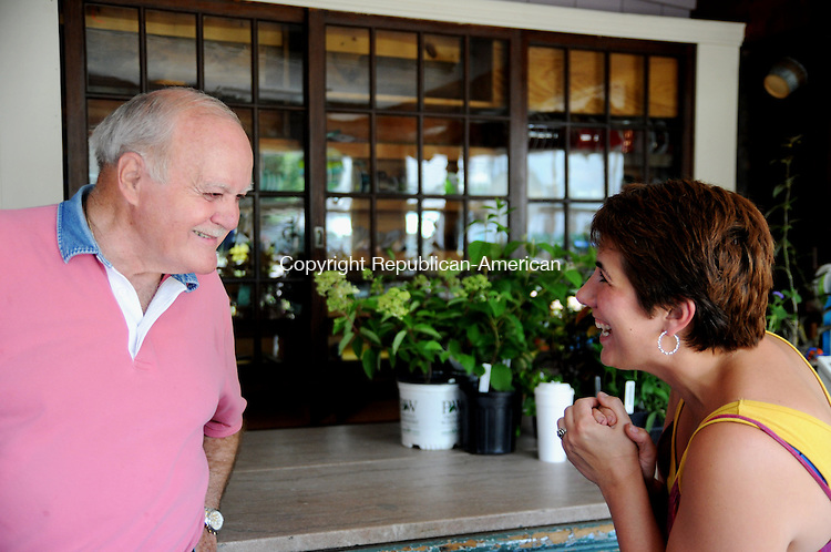 WINSTED, CT, 23 JUN 12-062312AJ01-  George Nedderman Jr., whose father George Nedderman, Sr., started Nedderman's Florist on Center Street in Thomaston in 1928 speaks with Melissa Daversa of Northfield who recently reopened the business on Saturday. Daversa renamed the shop Annabella's Garden..Alec Johnson/ Republican-American