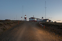 The light comes on after sundown at Cabo Espiritu Santo lighthouse on the Atlantic entrance to the Strait of Magellan in Tierra del Fuego, Chile.