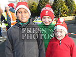 Isacc Smith, Cormac and Ronan Browne who took part in the Termonfeckin Celtic FC Santa run. Photo:Colin Bell/pressphotos.ie