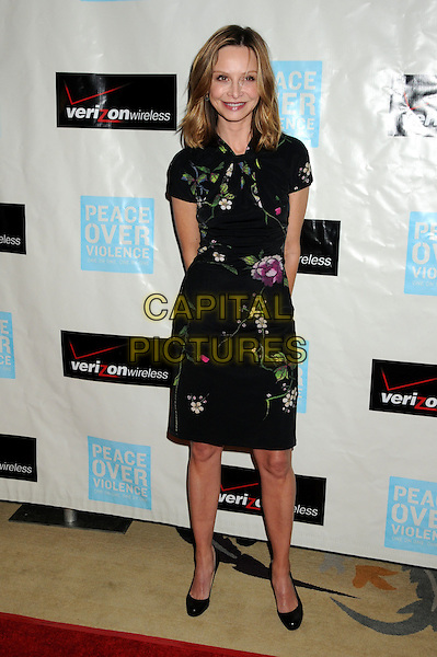 CALISTA FLOCKHART.Attending the 38th Annual Peace Over Violence Humanitarian Awards held at The Beverly Hills Hotel, Beverly Hills, California, USA, 6th November 2009..l length dress purple flower floral shoes black green embroidered print pattern christian louboutin heels .CAP/ADM/BP.©Byron Purvis/AdMedia/Capital Pictures.