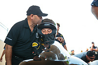 Jun 2, 2019; Joliet, IL, USA; Mike Salinas (left) kisses his daughter NHRA pro stock motorcycle rider Jianna Salinas on the helmet during the Route 66 Nationals at Route 66 Raceway. Mandatory Credit: Mark J. Rebilas-USA TODAY Sports