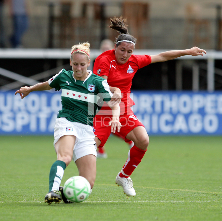 Chicago Red Star defender Natalie Spilger (13) clears the ball while being pressured by Washington Freedom forward Lisa De Vanna (17).  The Washington Freedom defeated the Chicago Red Stars 3-2 at Toyota Park in Bridgeview, IL on July 26, 2009.