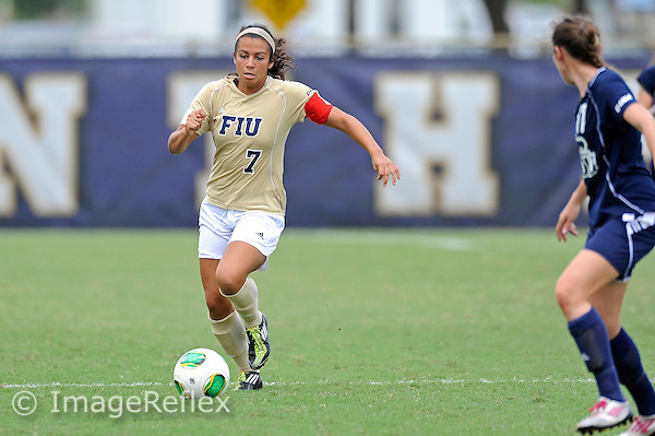 29 September 2013:  FIU midfielder/forward Kim Lopez (7) advances the ball in the second half as the FIU Golden Panthers defeated the Old Dominion University Monarchs, 4-0, at University Park Stadium in Miami, Florida.
