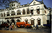 Zanzibar, Tanzania. Road building machines outside the Bharmal Building, an impressive Arab colonial building built in 1900 to house the British Commissioner.